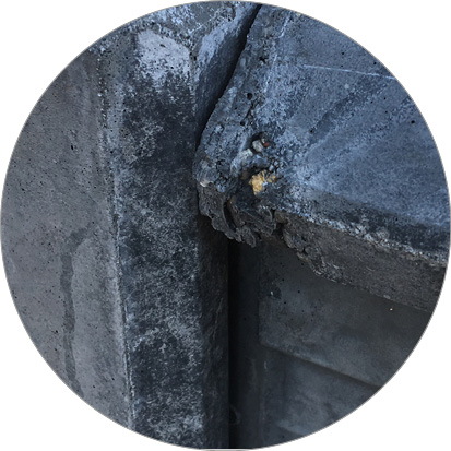 kapotte hoek betonplaat schutting